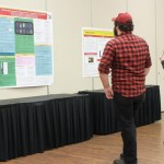 Attendees at Darwin Day Research Colloquium 2013 enjoying poster session.